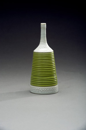 Narrow green porcelain vase by Peggy Loudon