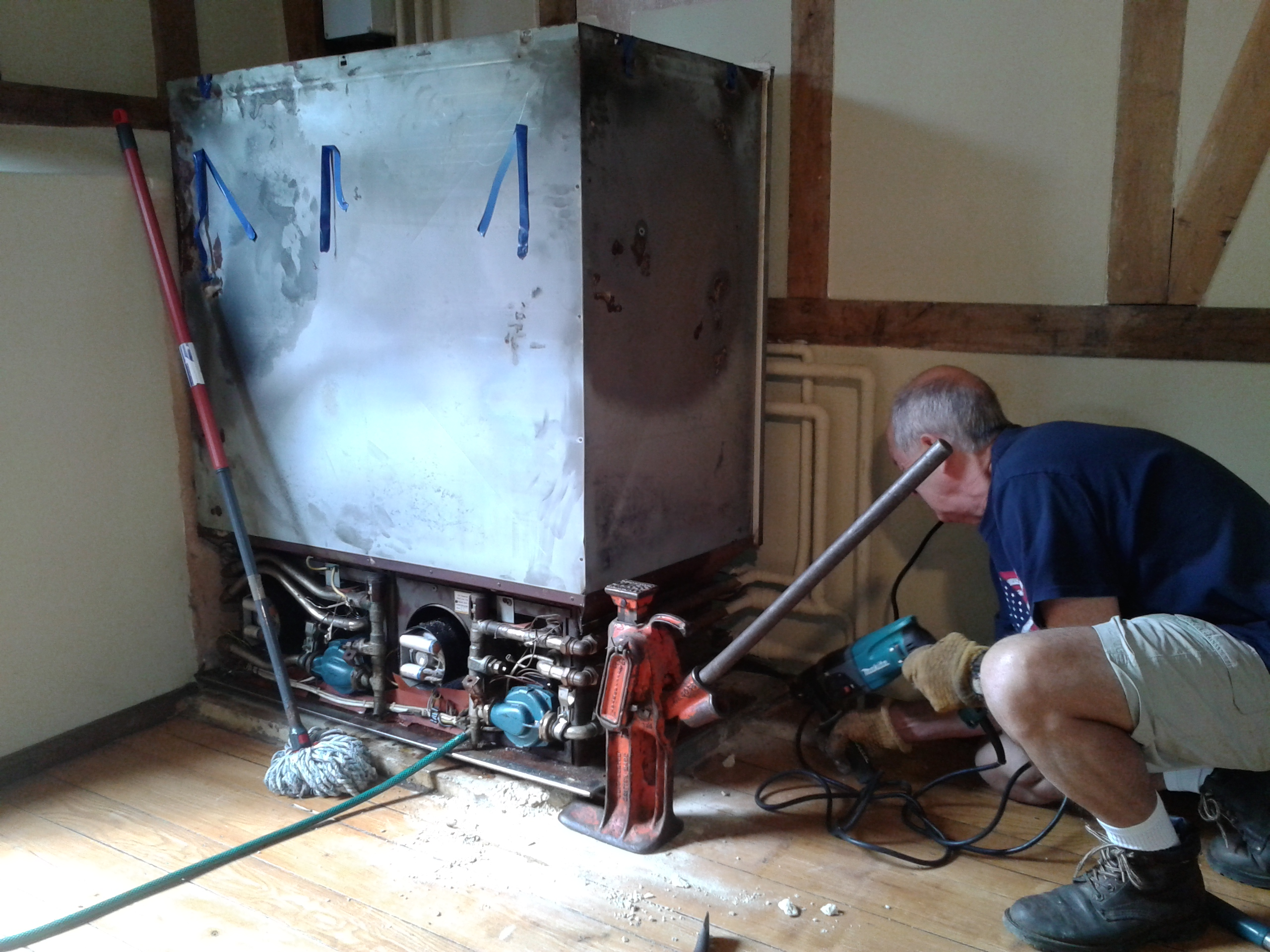 engineer gets ready to jack boiler away from floor